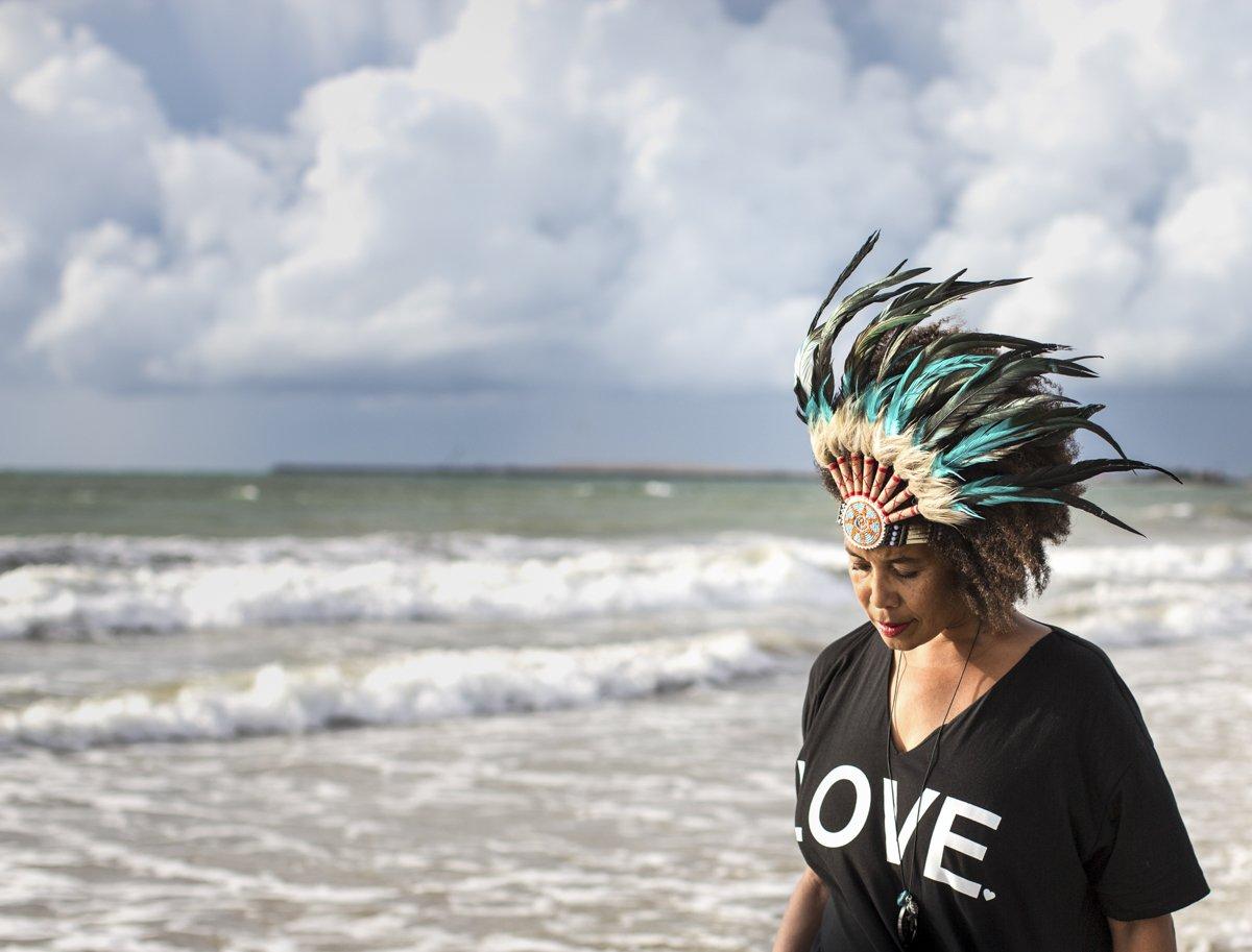 woman with head dress on beach