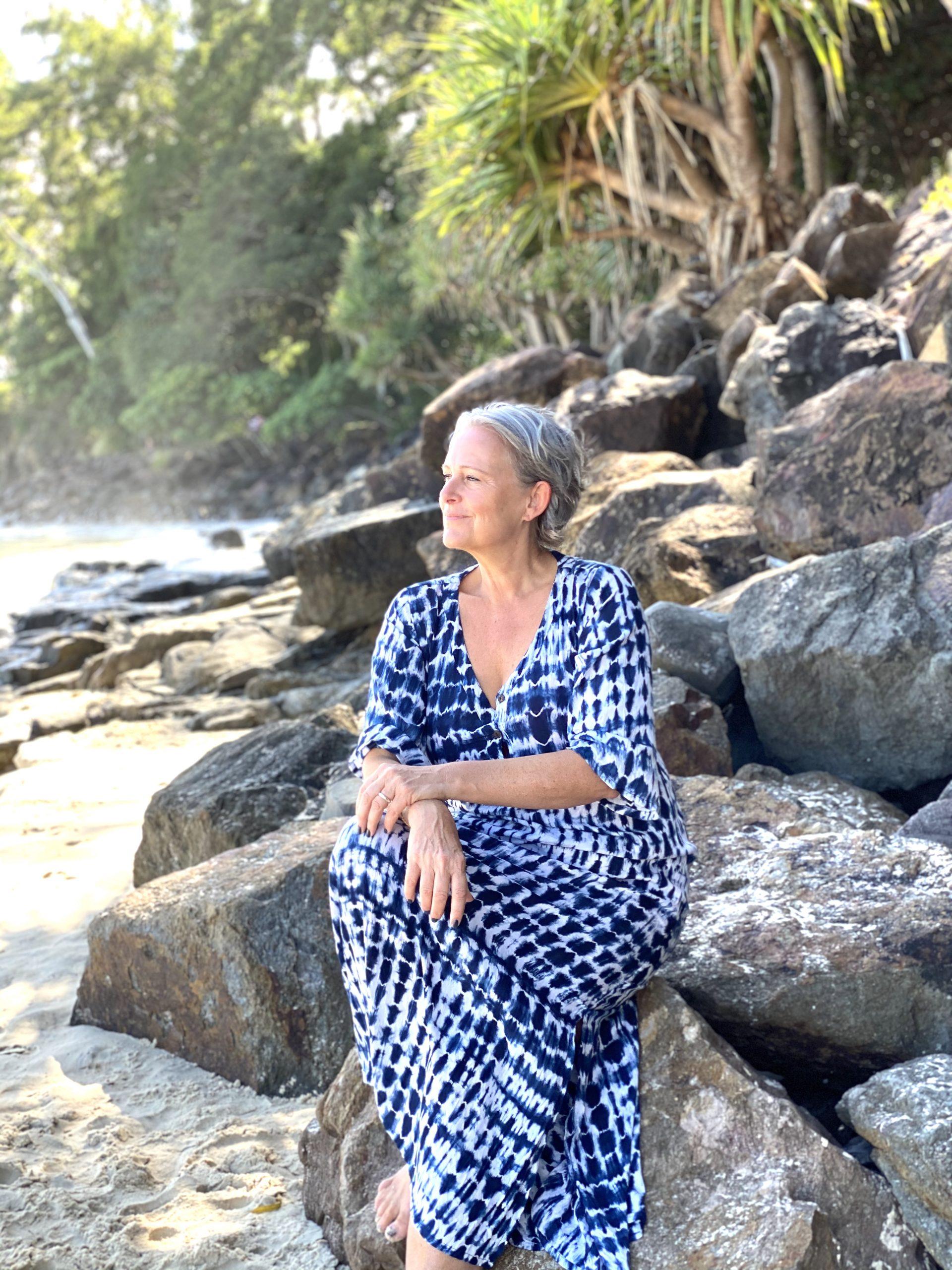 woman blue dress on beach